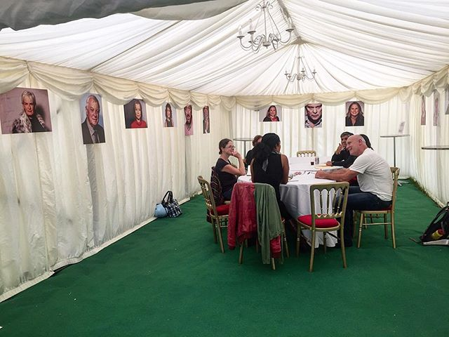 Writing workshop @wimbookfest surrounded by author portraits by @nickgregan.